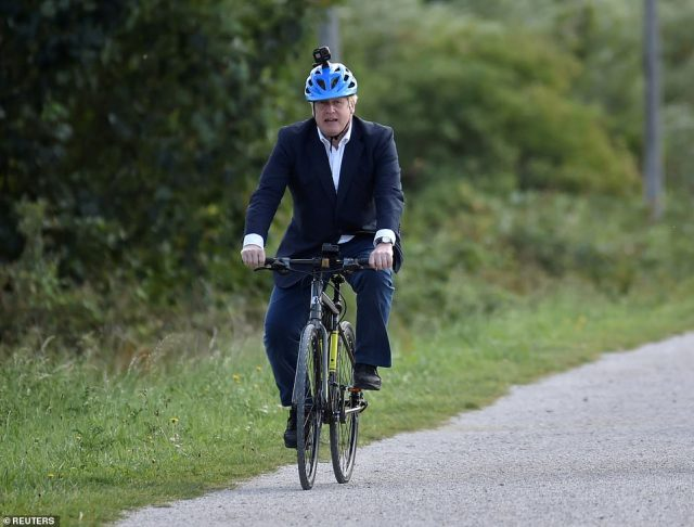 Boris Johnson was spotted at the Olympic Park seven miles away from Downing Street yesterday afternoon. Pictured, the PM cycling in Beeston last summer
