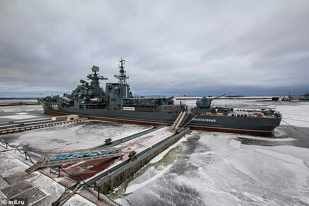The warship now functions as a floating naval history museum (pictured) on an island near St Petersburg