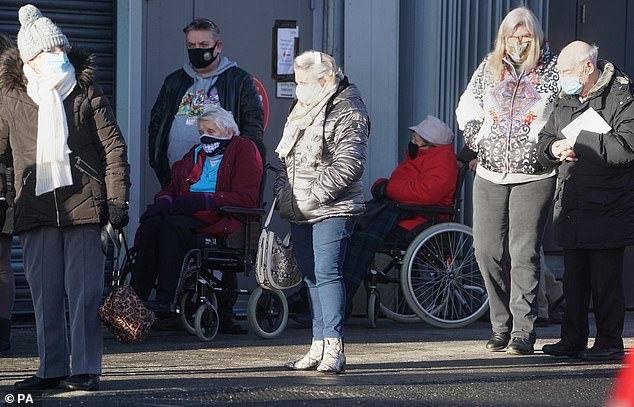 Members of the public arrive to receive their injection of a Covid-19 vaccine at the NHS vaccine centre that has been set up at the Centre for Life in Times Square, Newcastle