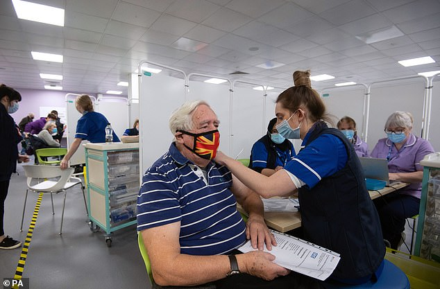 A man pictured receiving his vaccination at the centre in Stevenage, Hertfordshire