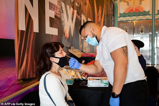 The CDC says it has no evidence that a mutant strain is responsible and other health experts concur. Pictured:A person gets tested for COVID-19 before working on the play Seven Deadly Sins at Lincoln Road in Miami Beach, Florida, December 2020