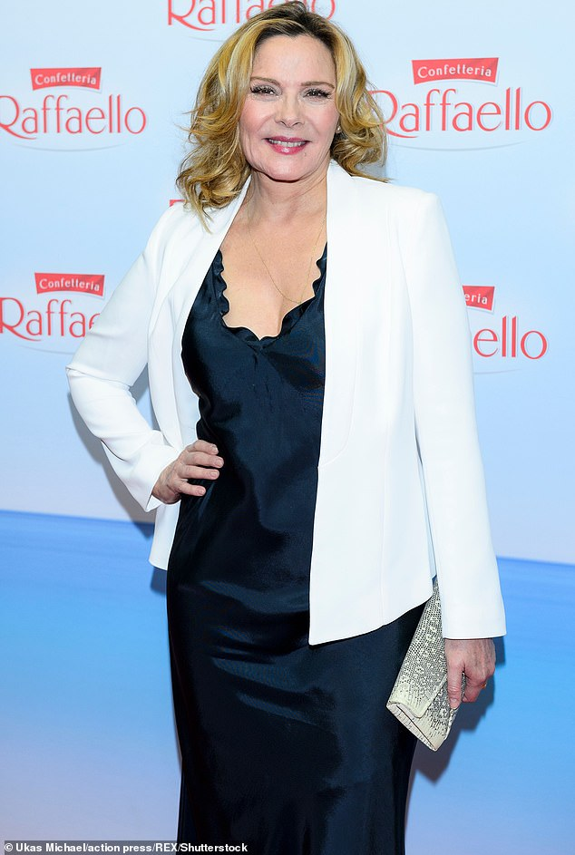 Keeping it classy:Kim Cattrall, 64, took a thinly-veiled swipe at her former Sex and the City castmates by 'liking' a fan tweet that applauded her for refusing to take part in the reboot