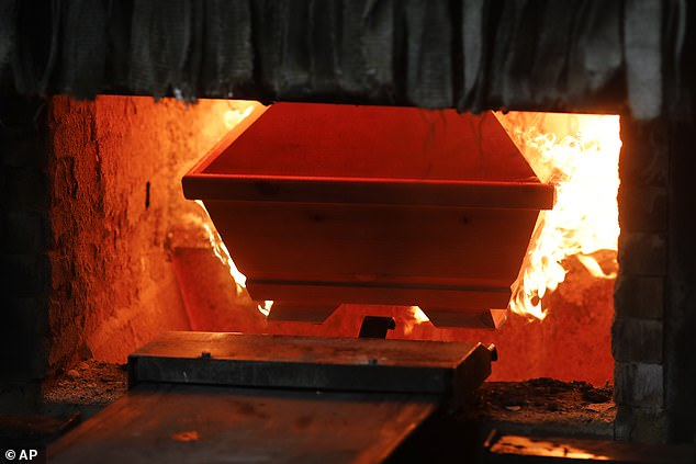 Joerg Schaldach, manager of the crematorium, says it is doing its best to keep up with demand, firing up the twin furnaces every 45 minutes and managing 60 cremations a day