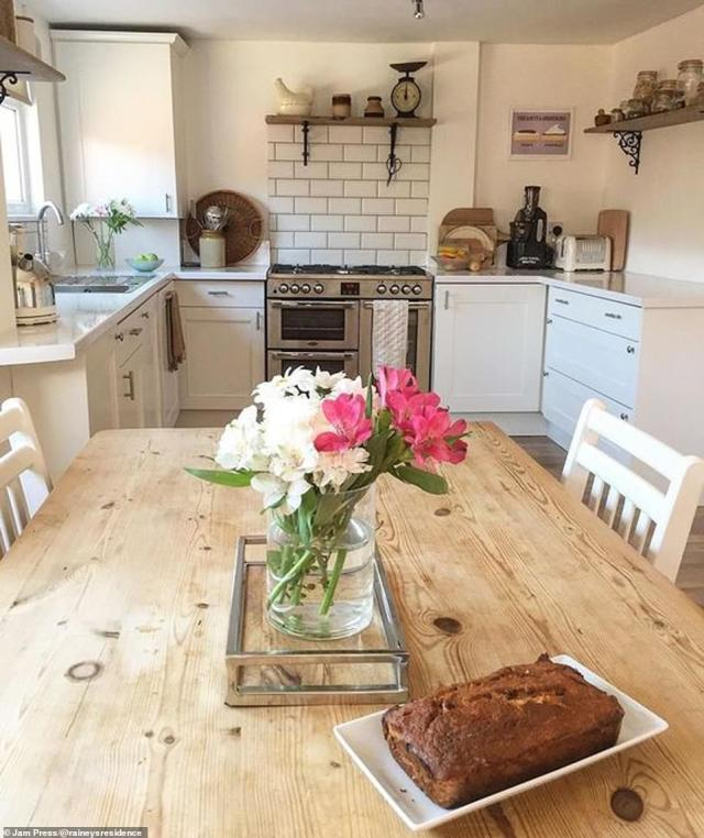 The kitchen (pictured after) was completely ripped out and replaced with fresh white units – bought second-hand on eBay for £400 – with wooden floor replacing the old black and white patterned floor tiles