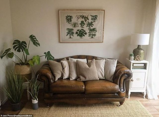 The dining room is pictured afterwards with a stylish leather sofa, house plants and tasteful furnishings