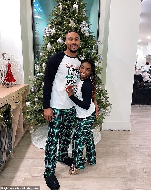 Jolly: On Christmas Day, Simone and her NFL star boyfriend, Jonathan Owens, wore matching pajamas while posing in front of the decorated tree that she had placed next to the wine bar