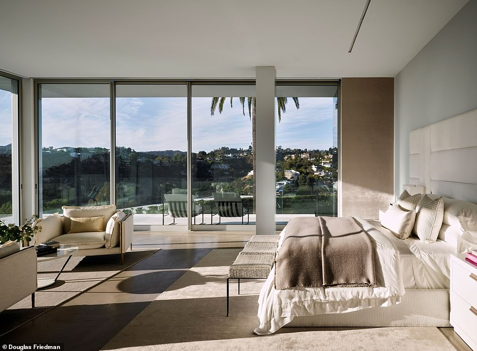 'We wanted to provide that quintessential L.A. living but on a bigger scale':Interior pictures show the home features floor to ceiling windows letting in the California sunshine