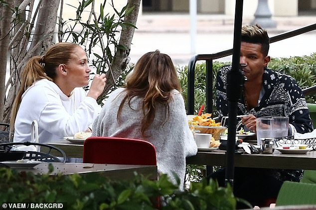 Lunched: Lopez and her friends were seated at an outdoor table distanced from other diners