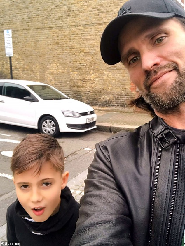 Scott Walker, originally from the Southern Highlands of New South Wales, is currently stranded in the UK with his 13-year-old daughter and 11-year-old son (pictured)