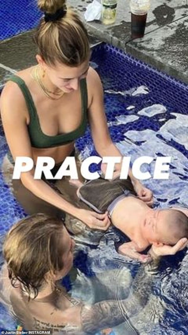 Preparing for fatherhood: 'Practice,' the pop superstar declared in a snap showing Hailey fixing his baby's shorts as her husband cupped his tiny head.