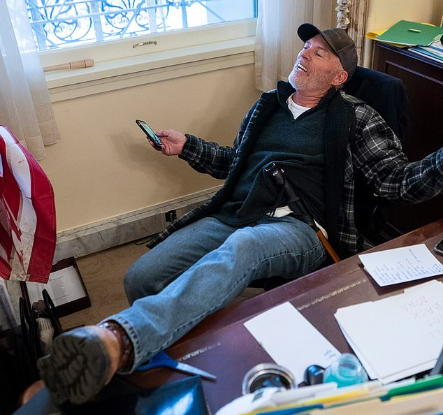 Barnett was photographed during the Wednesday Capitol riot inside Speaker Nancy Pelosi's office with his feet on her desk. He smiled and laughed as he lounged in her chair and he allegedly left a threatening note on her desk