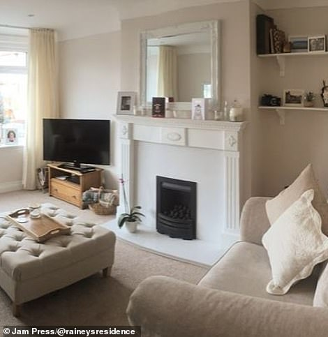 The dated living room was transformed into a chic space, featuring a stunning cream mantel with a black coal fireplace at the base