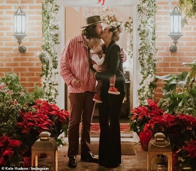 True love: ''It's the first time I feel like I have a real teammate in this,' she told Women's Health about her relationship with partner Danny Fujikawa; pictured December 10