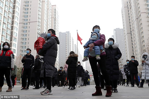 Millions were lining up in subzero temperatures to receive a second round of coronavirus tests in Hebei Province. This picture shows residents wait to be tested in Shijiazhuang on Tuesday
