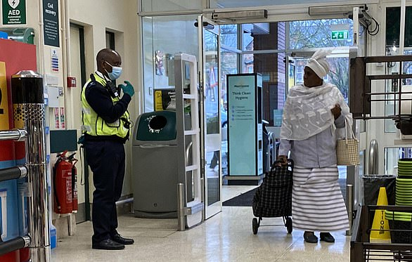 A woman is challenged yesterday for not wearing a mask at a Morrisons store in South East London