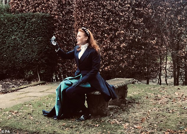 In the dramatic clip, Sarah, known as Fergie, is dressed in a period dress and gazes into a compass. Wandering in the gardens of Royal Lodge in Windsor, she tells the camera: 'Follow your heart. But do you dare'