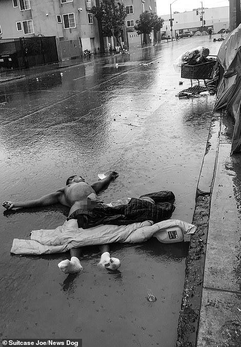 A disturbing scene showing a naked man sprawled on a rainy street in Skid Row.
