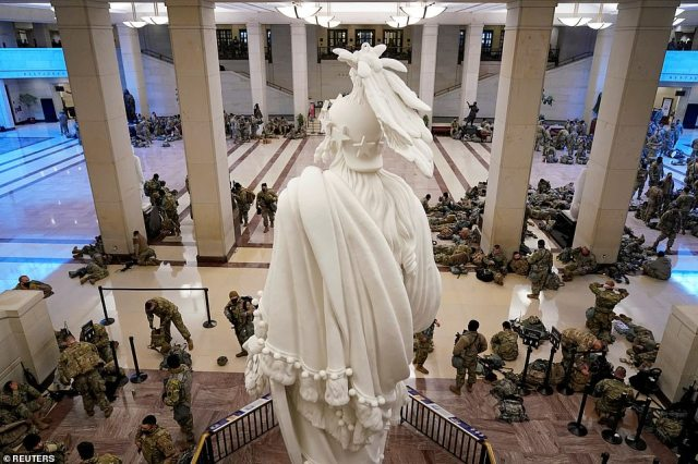 National Guard members assemble in the Capitol Visitor's Center on Wednesday before Democrats begin debating one article of impeachment against President Donald Trump. At least 10,000 troops will be deployed in by the end of the week
