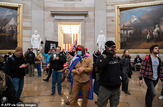 Supporters of US President Donald Trump walk around in the Rotunda after breaching the US Capitol in Washington, DC, January 6, 2021