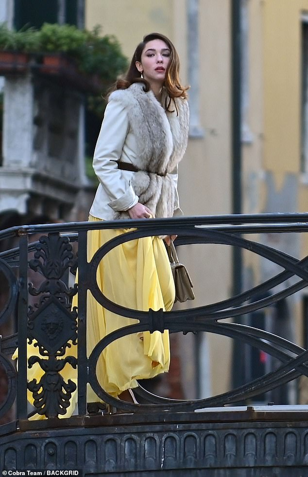 The Undoing star, 25, changed outfits during the day with the actress first filming scenes in a yellow ballgown with fur stole before changing into long pink coat.