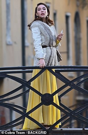 Beauty:Matilda cut a glamorous figure in the yellow floor length dress and a cream coat