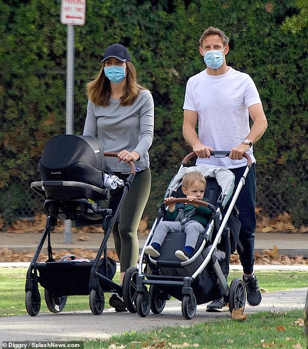 Sweet: The Formula 1 driver, 40, and his fiancee Brittny Ward, 30, were first seen since Lenny's arrival as they dated their newborn daughter and son