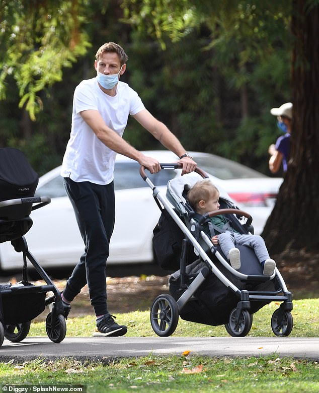 Discreet key: Jenson was also dressed in a white t-shirt and sweatpants