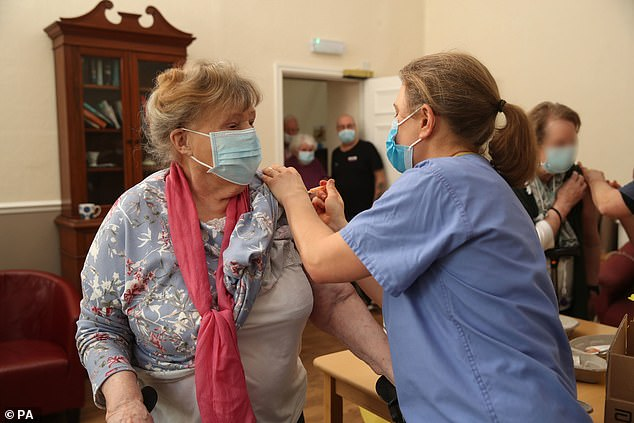 Resident Kate Stewart receives an injection of the Oxford/AstraZeneca coronavirus vaccine from Dr Jess Harvey at the Lady Forester Community nursing home in Wenlock, Shropshire