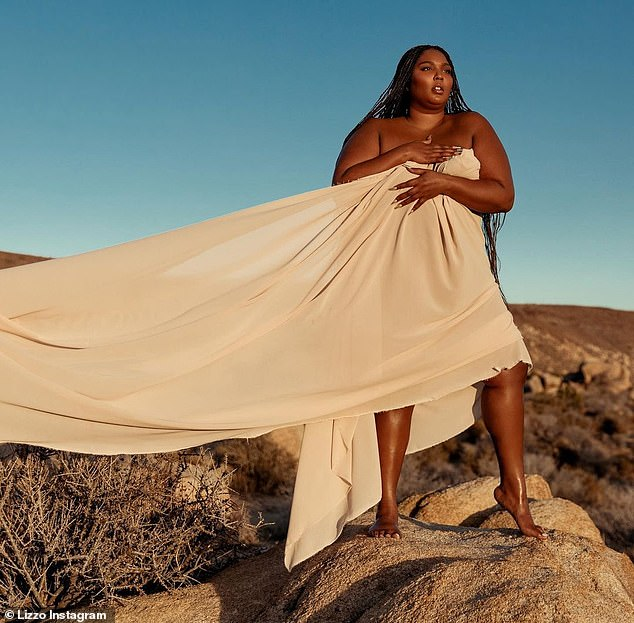 Baring it all: Lizzo embraced her body as she admitted that 2021 has already left her 'disappointed' in a new Instagram on Wednesday