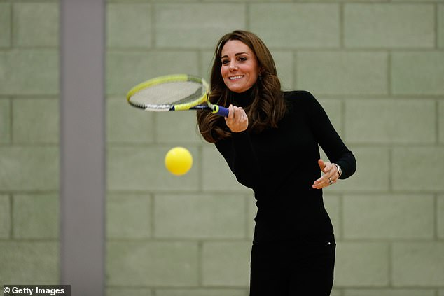Kate Middleton plays tennis as she joins a session with a group during a visit to the Coach Core Essex apprenticeship scheme at Basildon Sporting Village in 2018