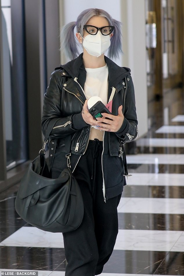 Trim figure: Kelly Osbourne, 36, shows off her 85-pound weight loss after having gastric sleeve surgery as she walks to a meeting in Beverly Hills while wearing a cropped top and sweatpants