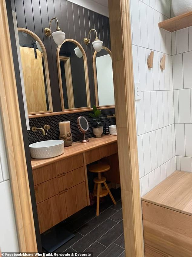There is also a matching wooden vanity in a side room (pictured). After sharing images on Facebook, the post was 'liked' more than 960 times and received praise from others who enjoy renovating