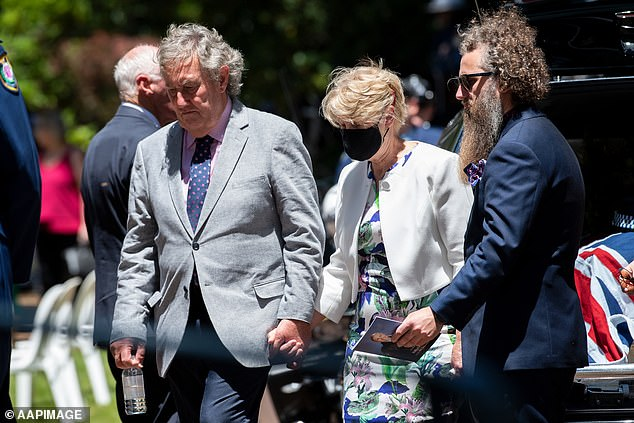 The parents and partner of Senior Constable Kelly Foster comfort each other at the funeral in Lithgow on Thursday