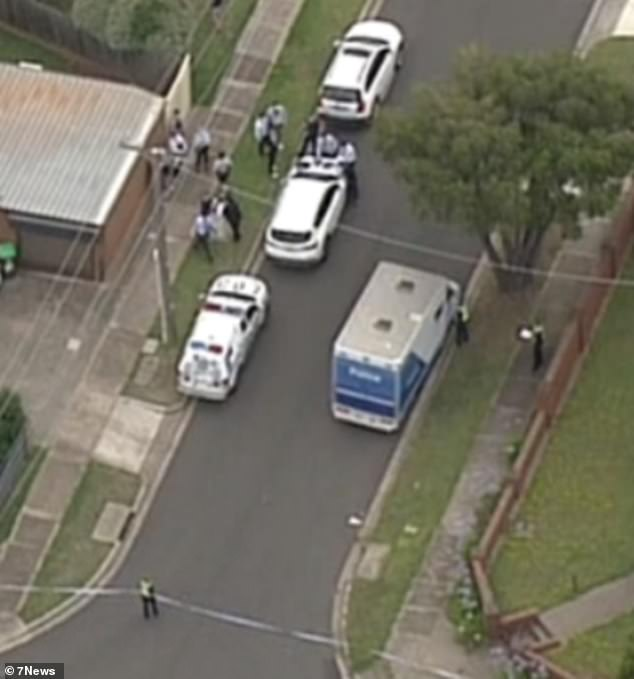 Aerial images from the scene show a heavy police presence, with the street cordoned off