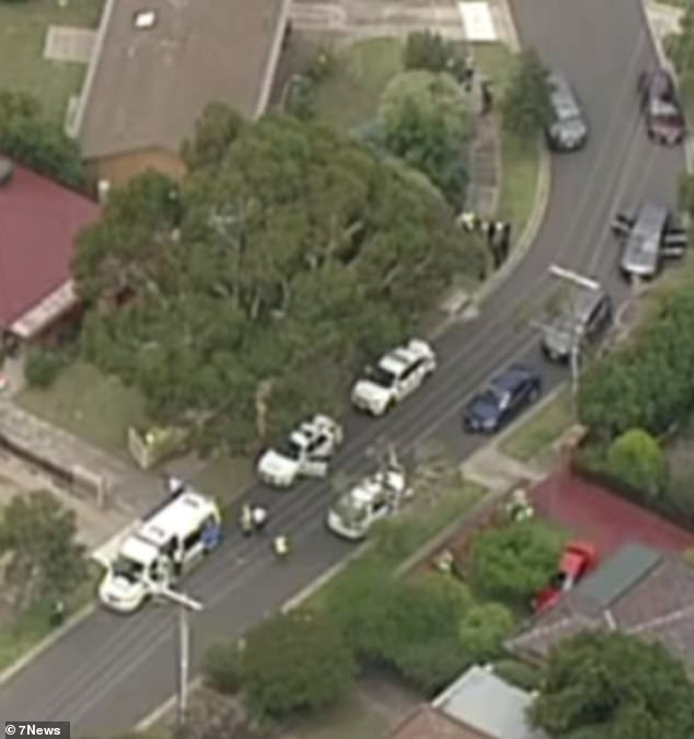Emergency crews were called to the house in Tullamarine, in the city's north-west, on Thursday afternoon. Pictured: Emergency crews are seen at the scene
