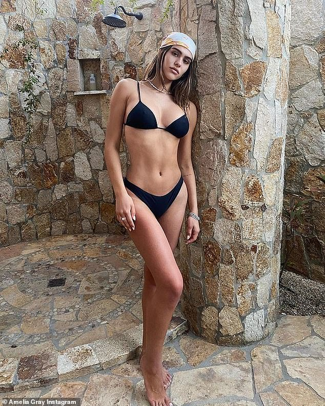 'Miss u': The 19-year-old model daughter of Real Housewife Lisa Rinna shared a snap from their vacation and suggestively captioned the photo 'miss u already'; pictured January 3