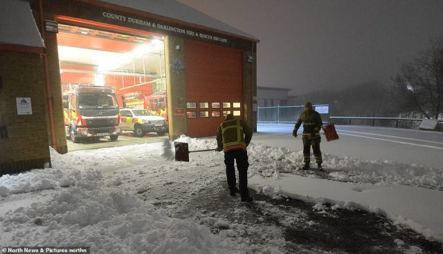 Crews from County Durham and Darlington Fire and Rescue Service dig out Consett Fire Station in the snow this morning