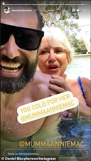 So cute!  He then posted two photos with his beloved mom Annie, joking that the water was 'too cold for her' as they spent some quality time together as a family.