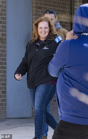 Jenny Cudd, front, a flower shop owner and former Midland mayoral candidate, and Eliel Rosa, rear, leave the federal courthouse in Midland, Texas, Wednesday