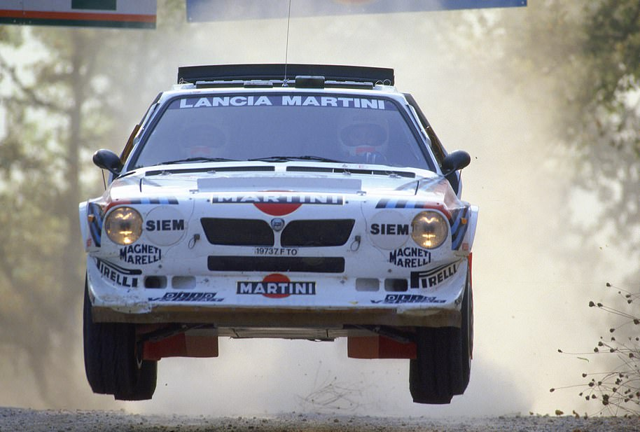 A Lancia Delta S4, piloted byMassimo 'Miki' Biasion, getting airborne during a stage in the Group B rally era