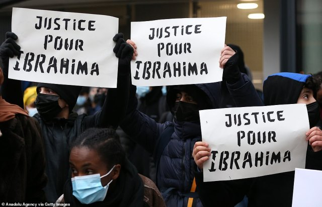 Protesters demanded authorities shed light on the circumstances surrounding the man's death on Saturday night. Pictured:Hundreds of demonstrators gather around 'Gare du Nord' during a demonstration, some holding signs that said 'justice forIbrahima' (pictured)