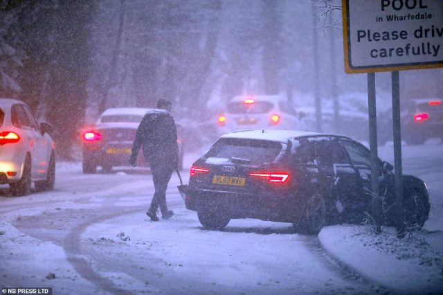 Traffic chaos in the village of Pool-in-Wharfedale near Leeds this morning as a car becomes stuck