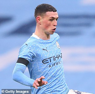 After playing against Birmingham City on January 10 (pictured), Phil Foden of Manchester City's hair looked remarkably shorter as he took on Brighton & Hove Albion on January 13