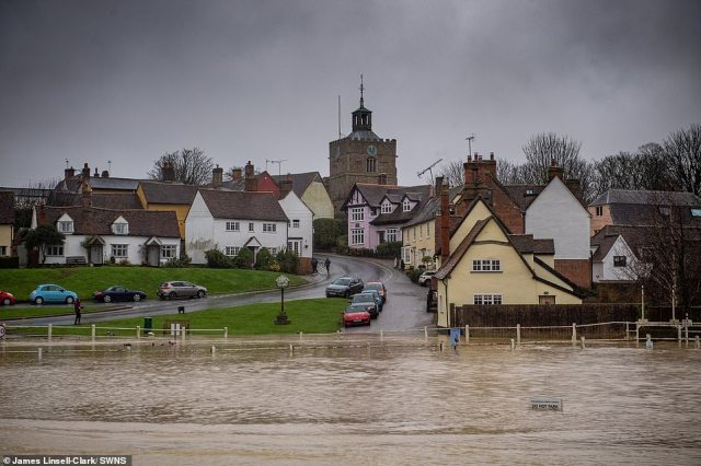Flooding in the village of Finchingfield in Essex today as much of the South East experiences high levels of rainfall