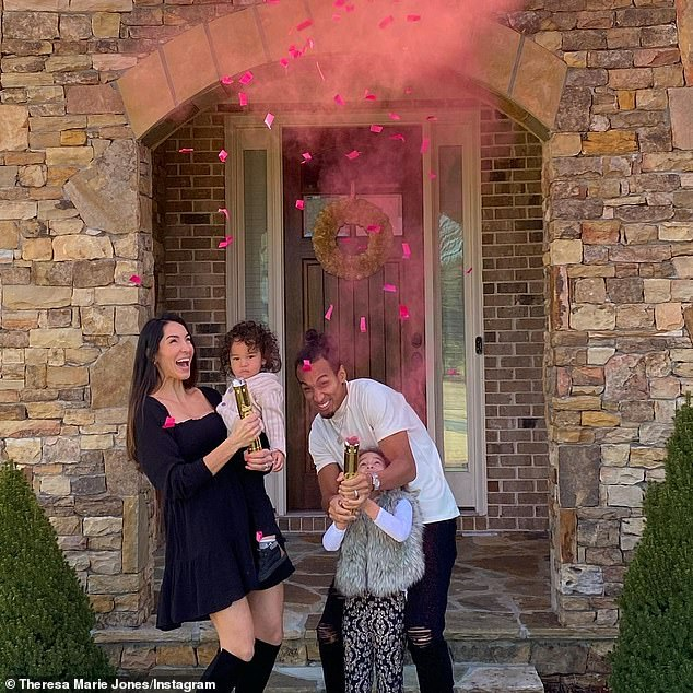 Congrats! In one snap, Theresa stood outside of her home with her husband and children as they shot a colorful cannon into the air and revealed a baby girl was on the way