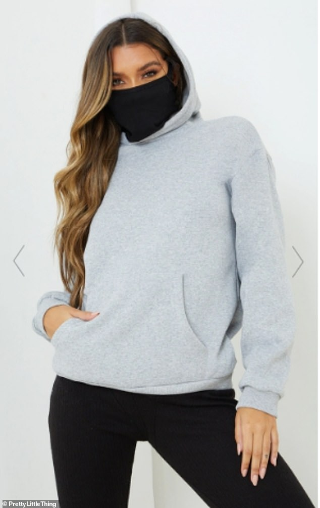 The product description reads: 'Featuring a grey material with a built-in mask and an oversized fit, team this with comfy bottoms and fresh kicks for an off-duty combo we are seriously crushing on' (pictured)