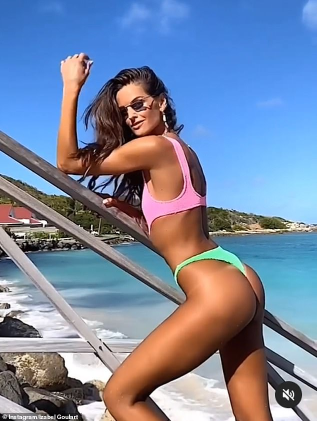 Cheeky:Izabel Goulart looked incredible as she slipped into a cut-out swimsuit for a stroll down the beach in St Barts on Thursday