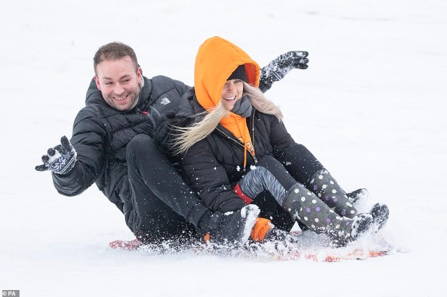 Michael McInally and Katie Black sledging at Glencourse Golf Course near Penicuik in Midlothian this afternoon