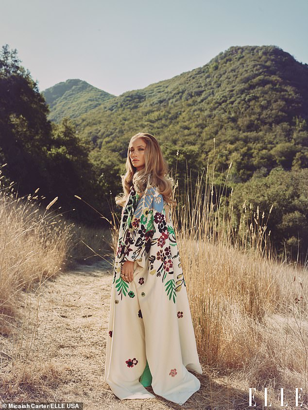 Flower power: The actress strolled through the canyon in an opulent floral print number