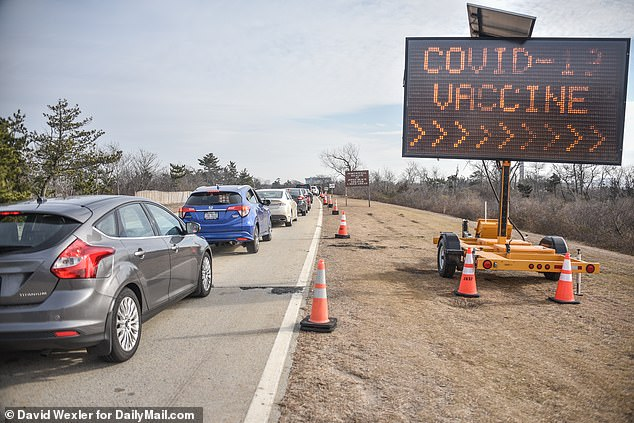 Cars in New York on Wednesday aspeople arrive for their COVID-19 vaccines by appointment